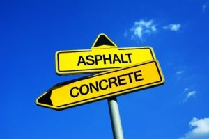 """Signpost with arrows reading """"concrete"""" and """"asphalt"""""""